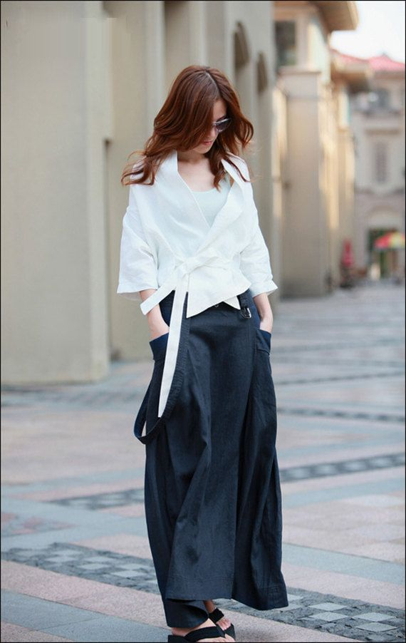 2010s: Gorgeously fluid look in classic ensemble of white shirt and black skirt.