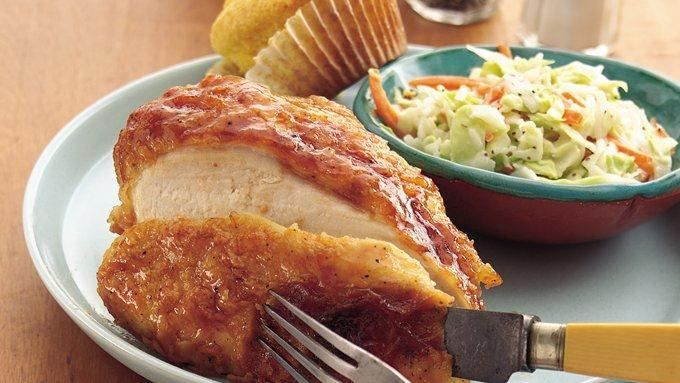 Bypass the fryer in favor of this crisp baked chicken alternative. It's coated in honeyed barbecue sauce just before serving for a delicious finish.