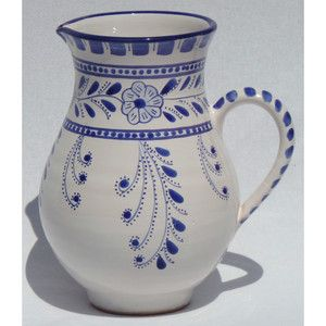 Beautiful. I love the almost Swedish blue and white, but with the Mediterranean swirly details that you don't find in Nordic ware.