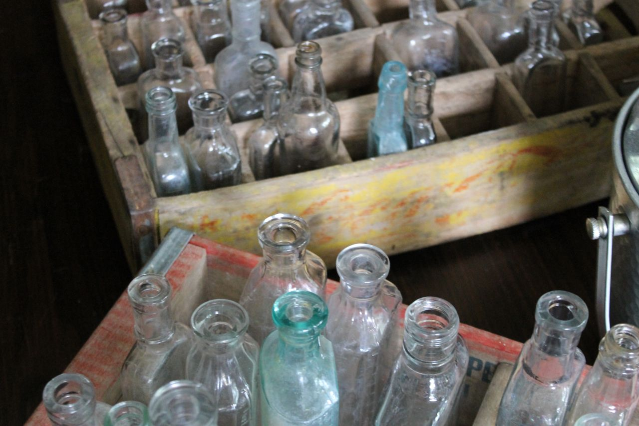 antique bottles in coke crate