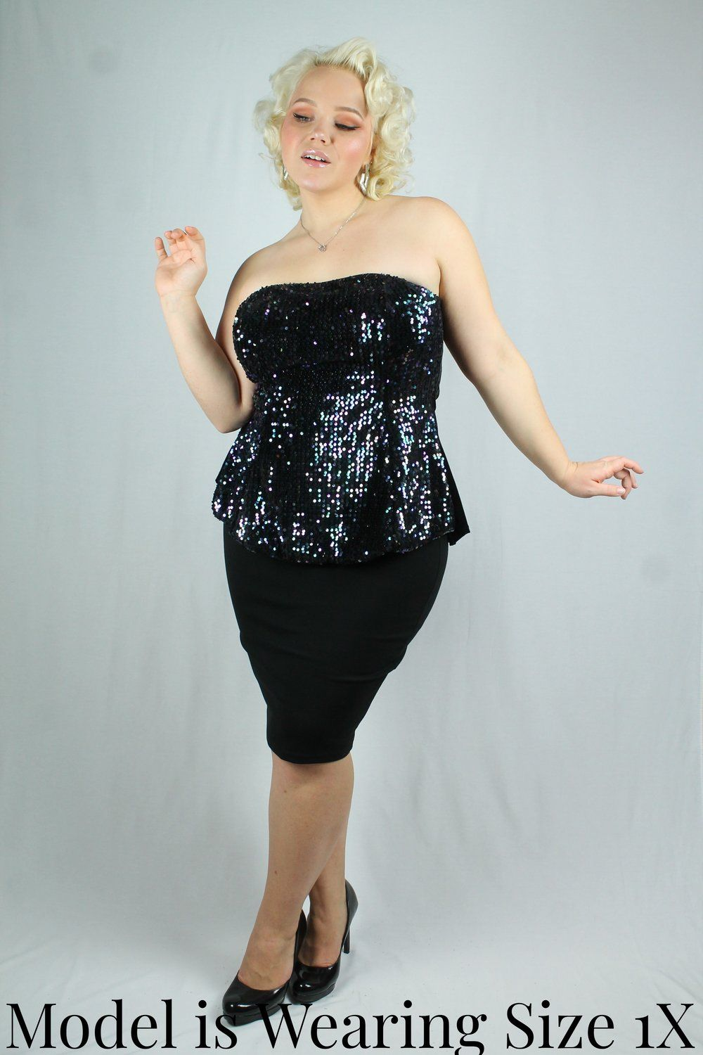 f686c19fd0385 Gorgeous iridescent sequin tube top in a peplum type cut. Fitted across the  bust