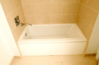 How To Fix A Water Damaged Plaster Wall Beside The Bathtub