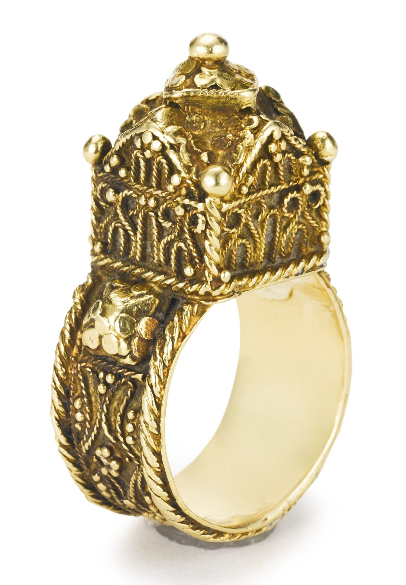 A gold granulation and filigree wire work wedding ring