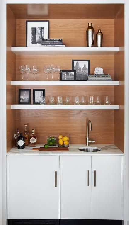 Amazing Wet Bar Features White Cabinets Topped With Statuary