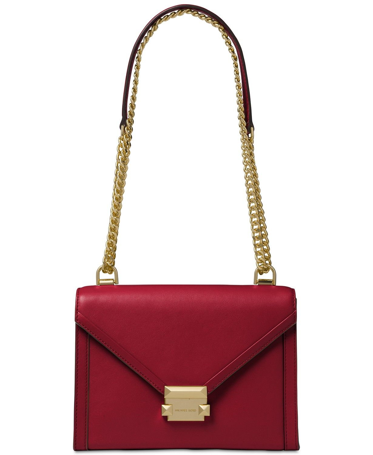 1296bfaa0d67 A polished chain strap and timeless push-lock closure elevates the allure  of the MICHAEL Michael Kors Whitney Shoulder Bag.