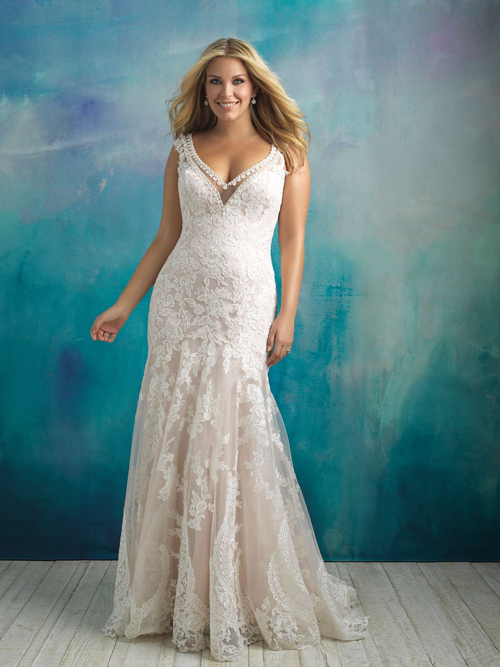 This Allure Women W411 trumpet plus size bridal gown is topped with ...