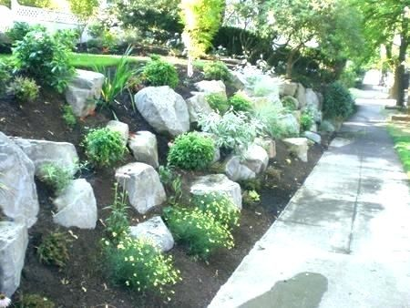 steep slope landscaping slope pe boulders in the garden on ...