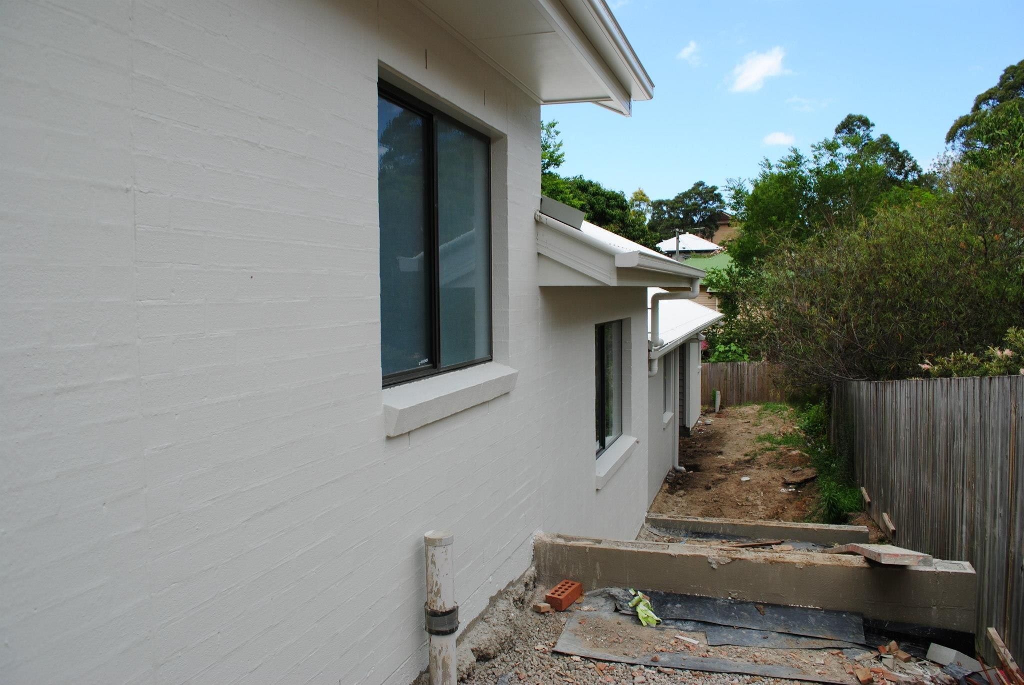 Colorbond surfmist render with black windows new house - Painting exterior walls rendered ...