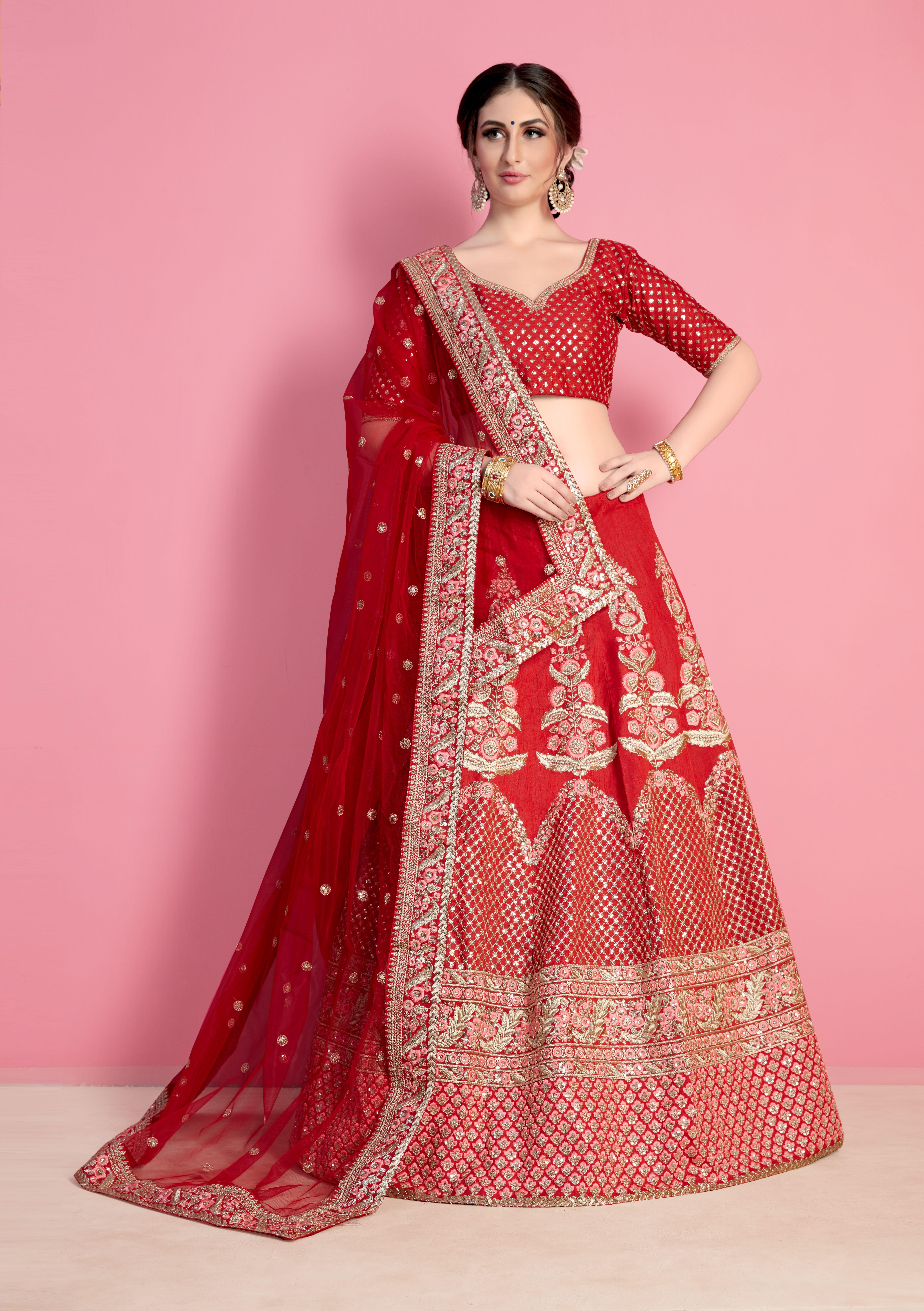 50b7ab67a0 Red art silk heavy embroidered bridal lehenga set. This lehenga set is  adorned with resham