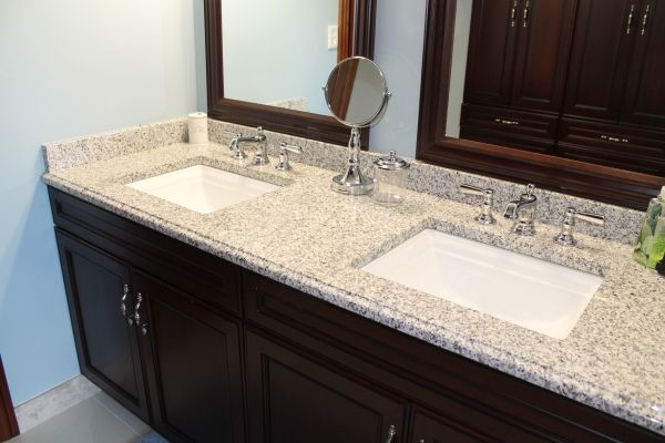 Blue Bathroom With Luna Pearl Granite Countertops And Two Built In