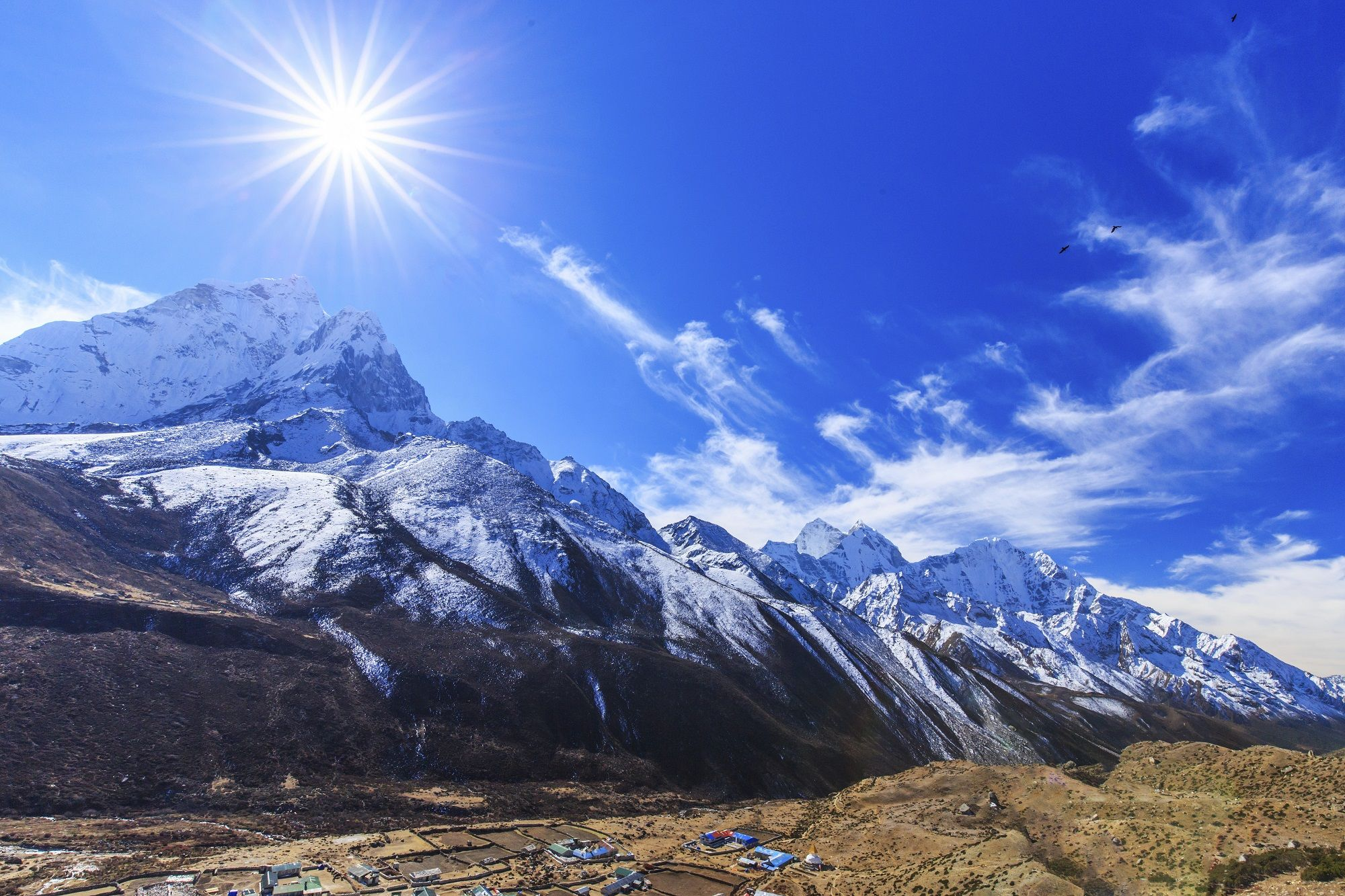 Weather pictures of the month: November 2014. MT. AMA DABLAM, NEPAL Mountain scenery in Himalaya with snow covered mountains, glacier valley and stone buildings.