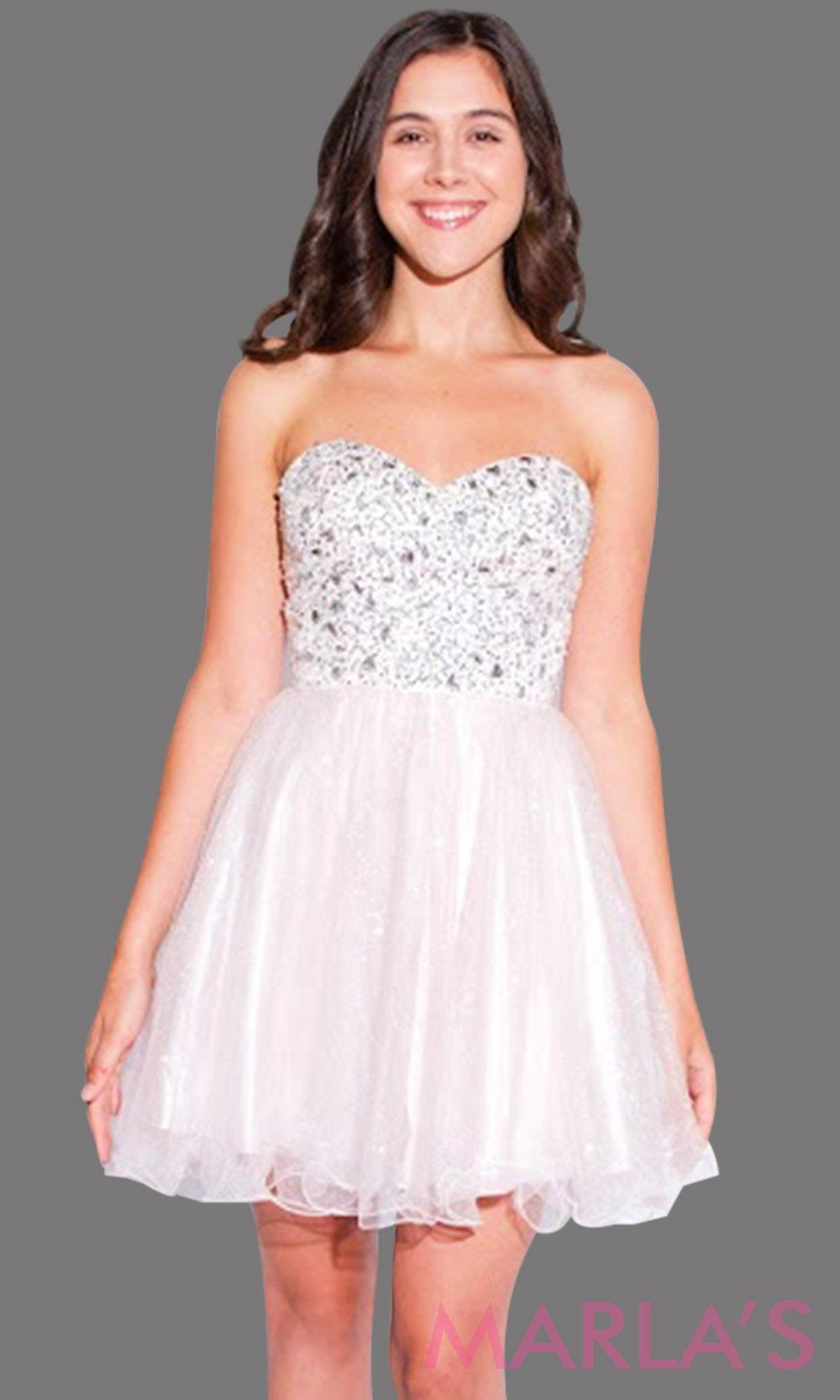 fc56c02275 Short blush pink graduation dress with rhinestone bodice. It has puffy  tulle skirt. Perfect for grade 8 grad