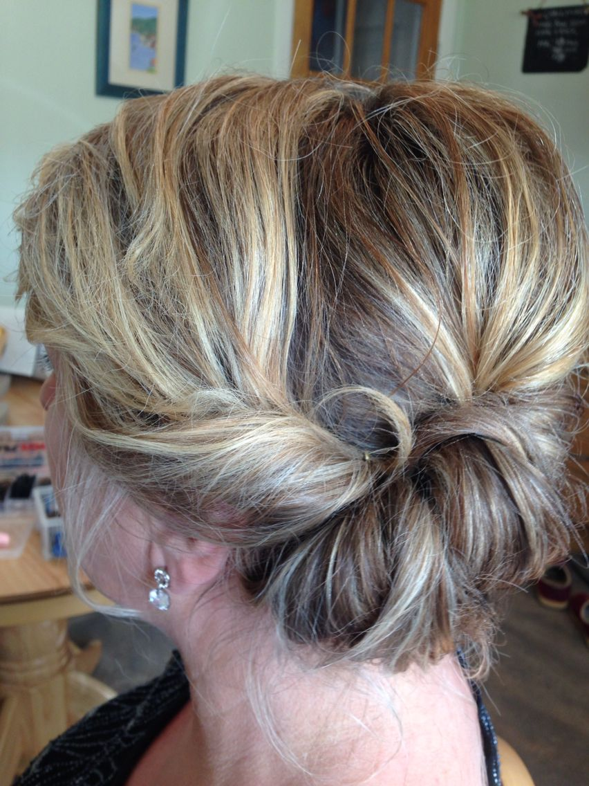 roll to the side twist mother of the bride loose updo