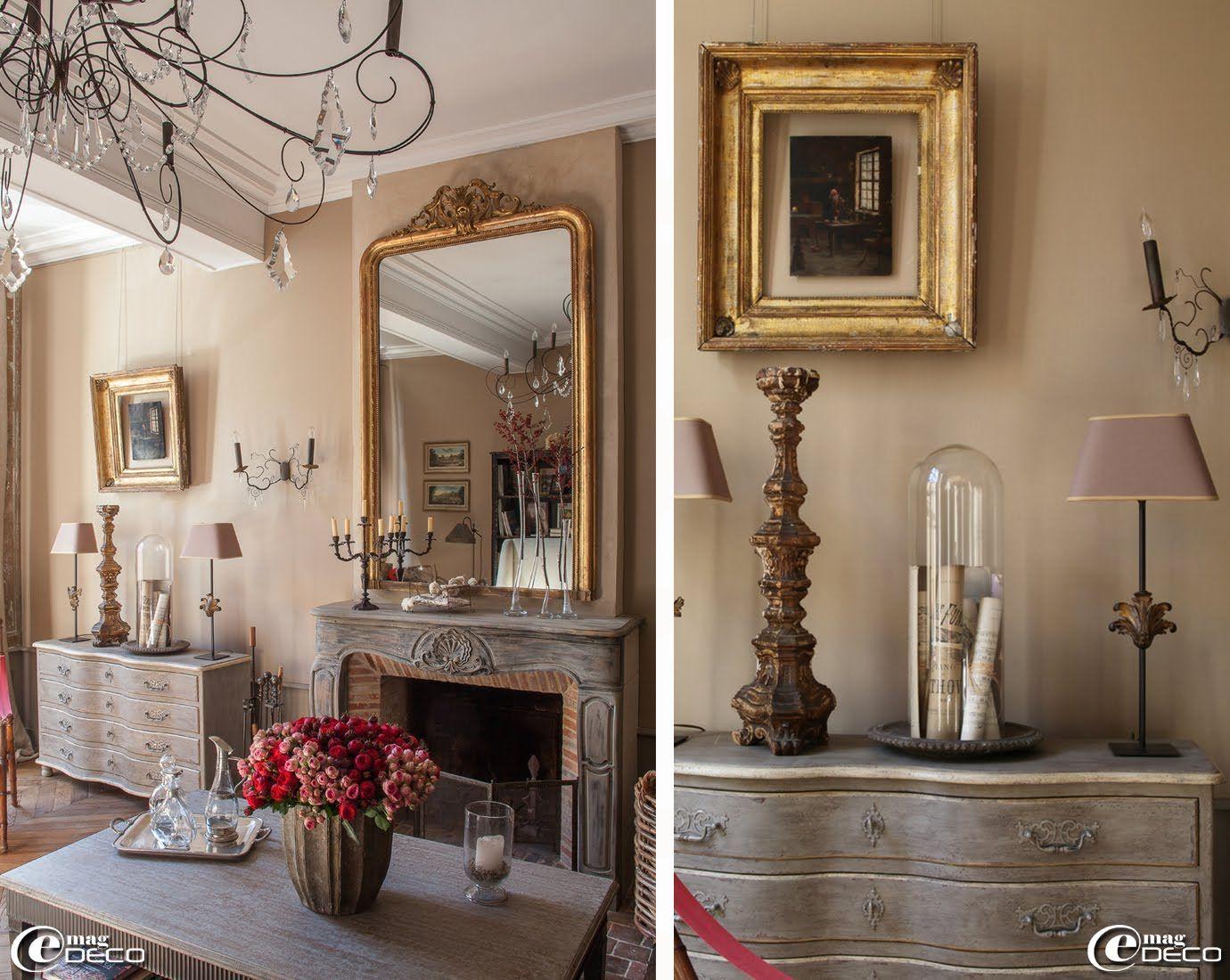 Cheminée de style rocaille en bois patinée, grand miroir doré XIXème, lustre 'Vox Populi' et table basse patinée à pieds fuseaux 'Blanc d'Ivoire'