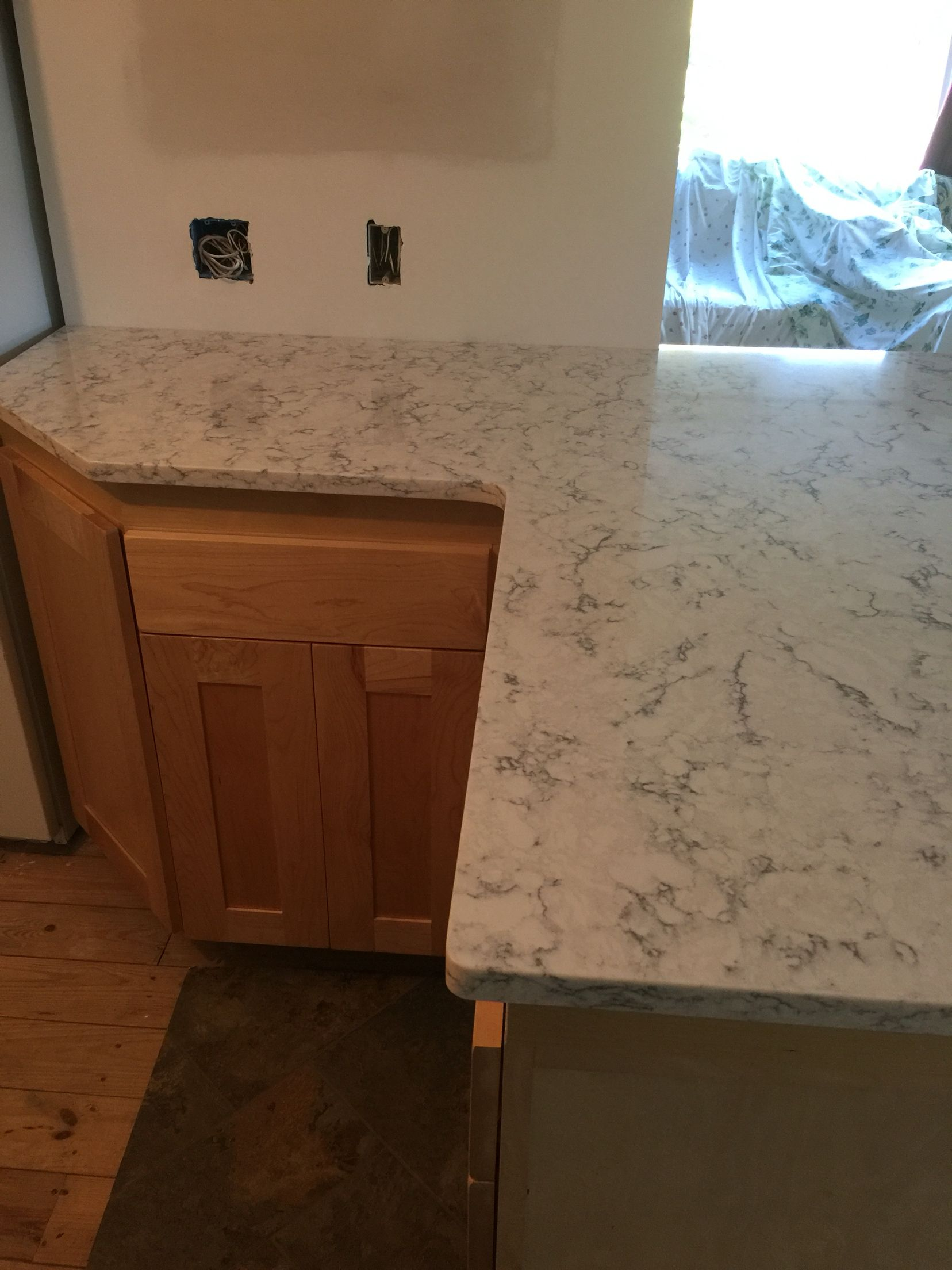 Lg viatera rococo with clear coat maple cabinets for Maple slab countertop