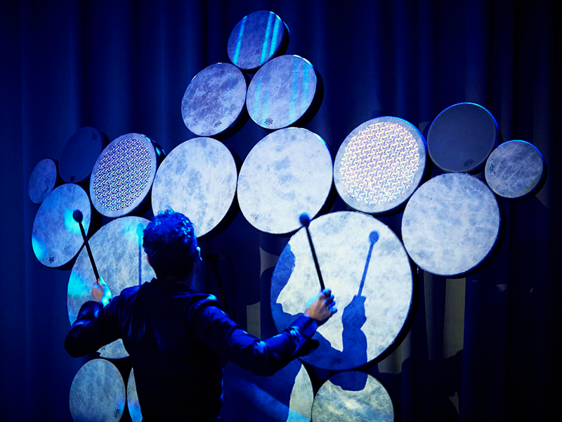 The one-of-a-kind Drum Wall consists of 136 drums and was created uniquely for Sonic Odyssey on Quantum of the Seas.
