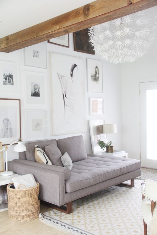 Light living room with gallery wall  exposed beams  LIVING ROOM