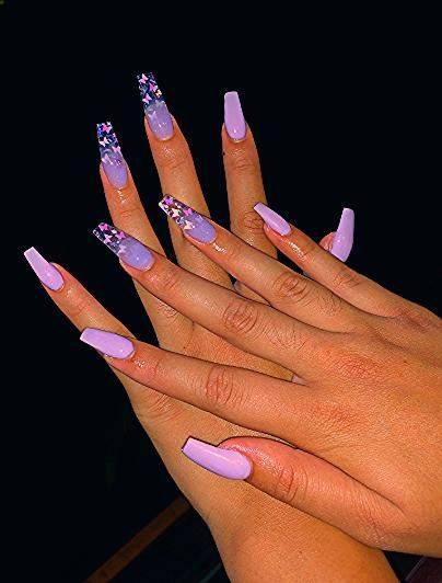 Photo of butterfly acrylic nails