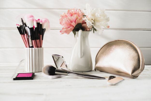 Download Brushes And Cosmetics Near Flowers And Bag for