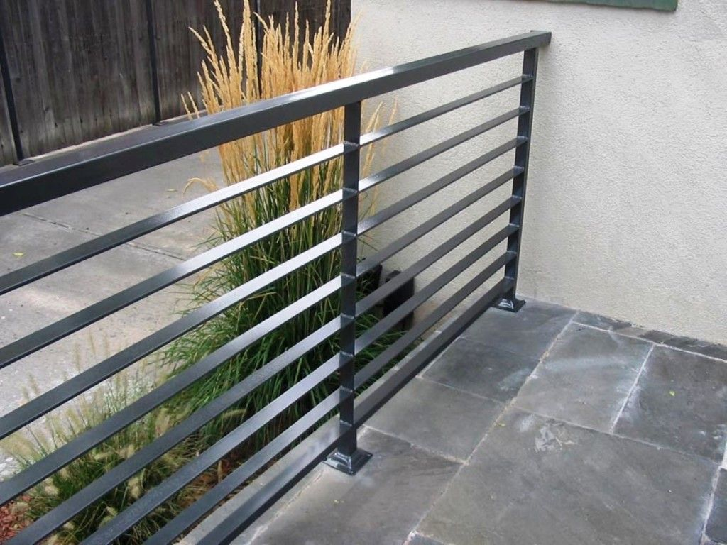 Interior modern grey metal balcony railing with stoned for Balcony steel railing designs pictures