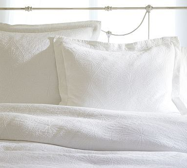 I could pair a white matelasse comforter like this (my mom has one she can let us use) with Tiffany blue damask patterned sheets and a solid Tiffany blue throw blanket at the end of the bed. Marion Matelasse Coverlet & Sham #potterybarn