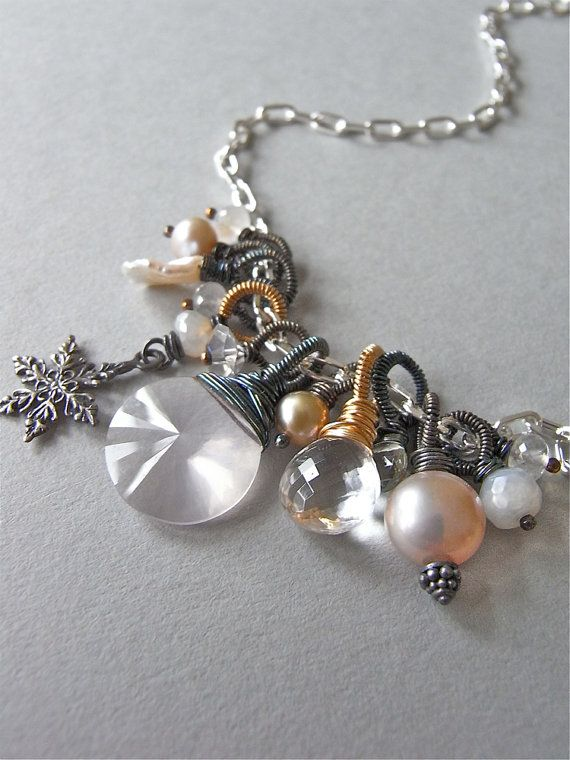The Tilda necklace - a beautiful collection of painstakingly wirewrapped treasures sway from a bright sterling chain.