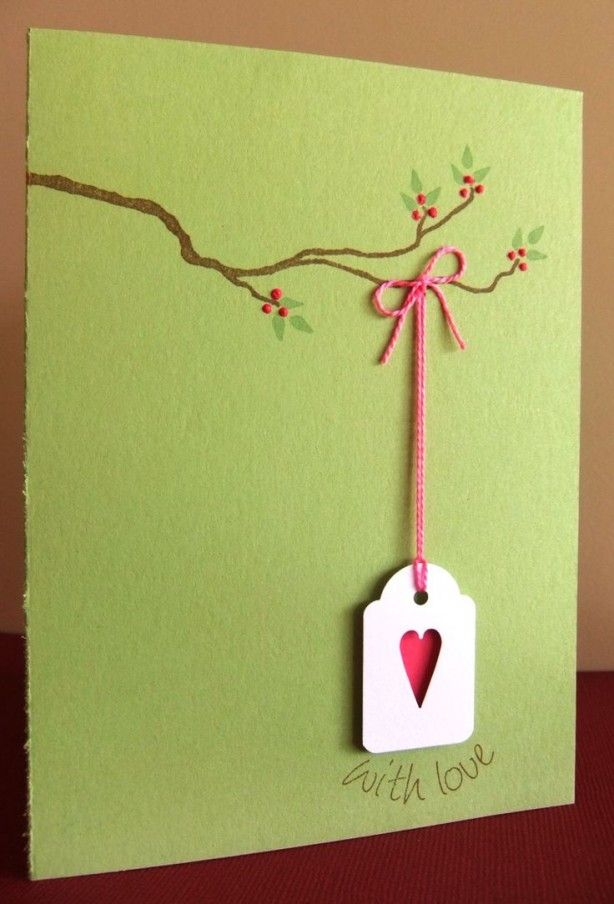 """the one i said """"that is flipping adorable"""" about, it's a branch with a heart hanging off it on string"""