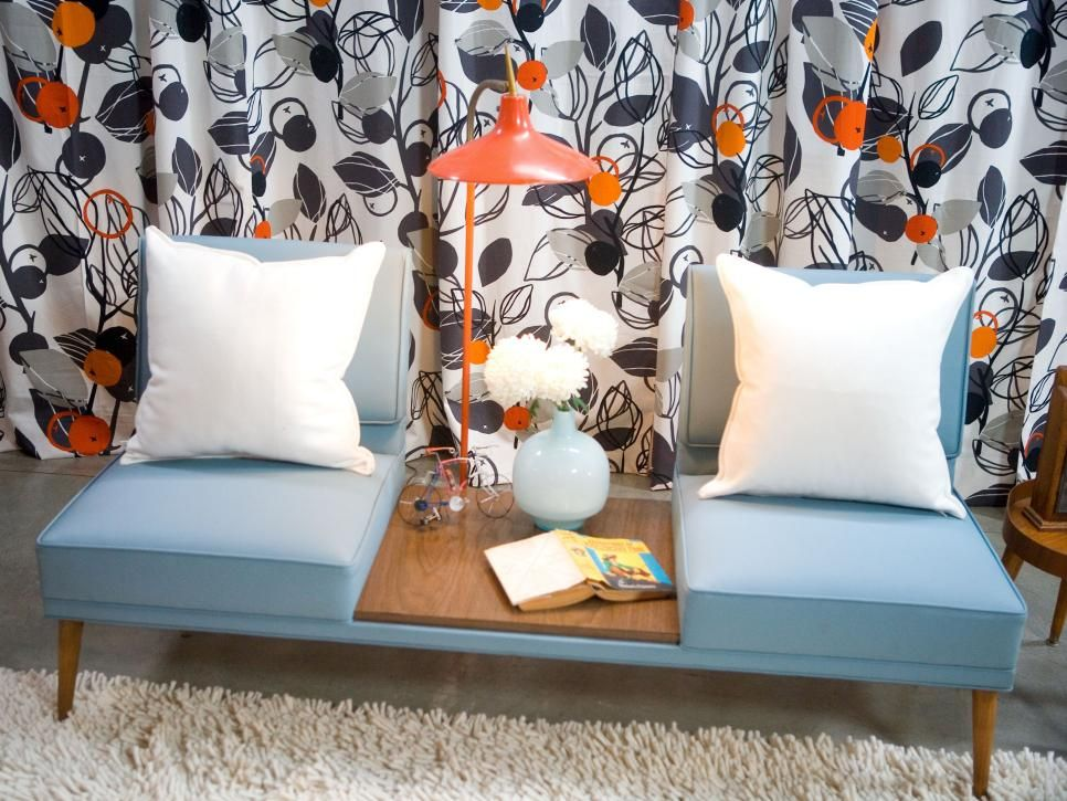 For this mid-century modern living room, a blue double chair is - wohnzimmer rot orange