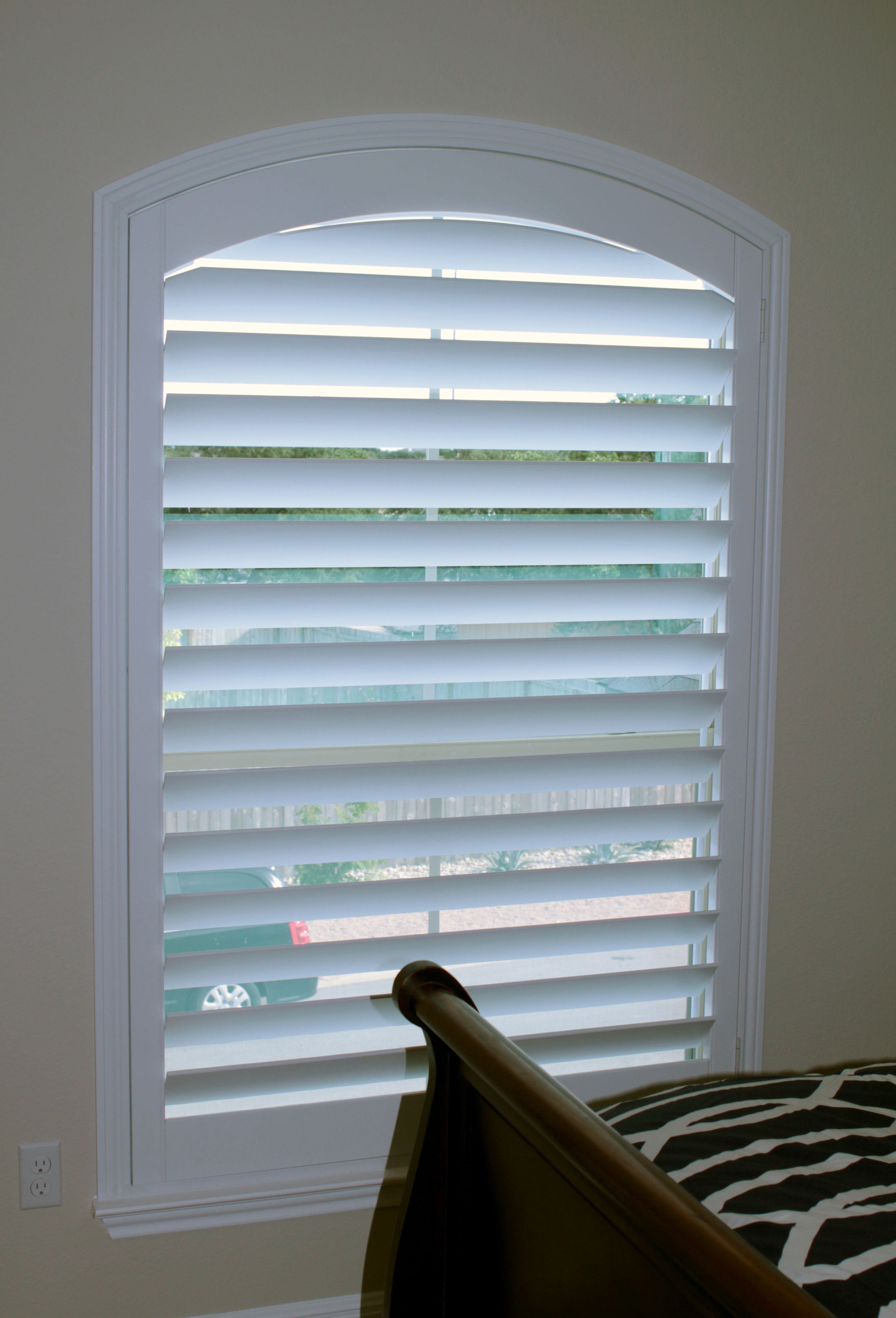 A real wood arched shutters is the only proper way to