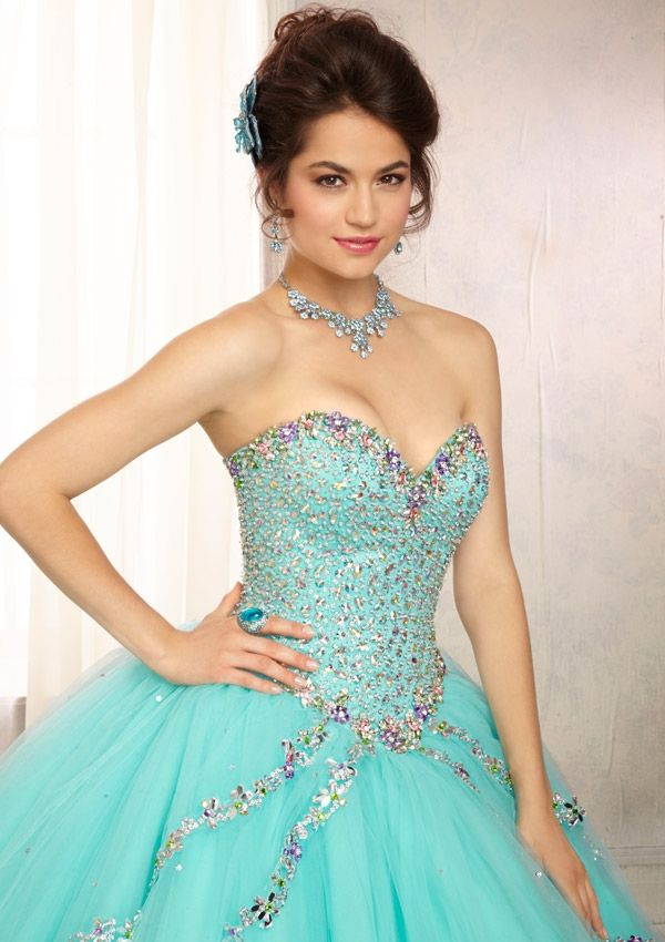 9a56fe7402 Quinceanera dresses by Vizcaya 88091 Multi-Colored Jewel Beaded Bodice on a  Tulle Ball Gown Skirt with a Sweep Train Matching Bolero.