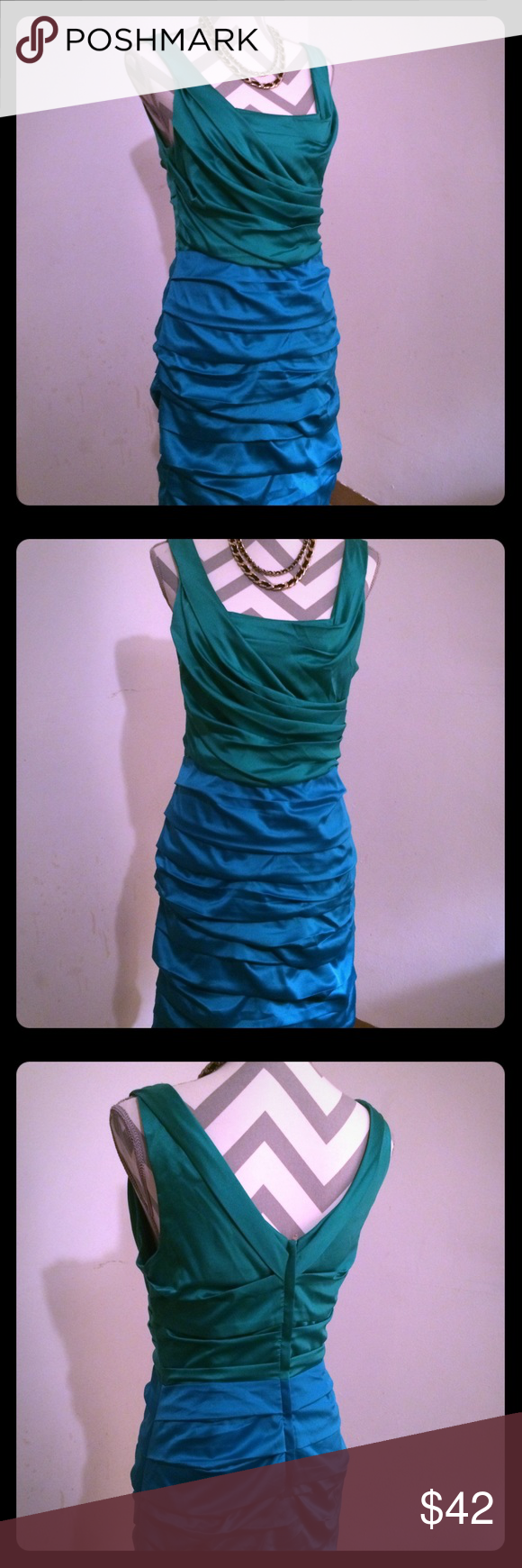 Elegant Express blue and green ruched dress. Green top, and blue bottom gives this dress an artsy and unique look by putting the two colors in one dress.  Nice lines, fitted party dress.  Size 10,  zip closure down back. Express Dresses