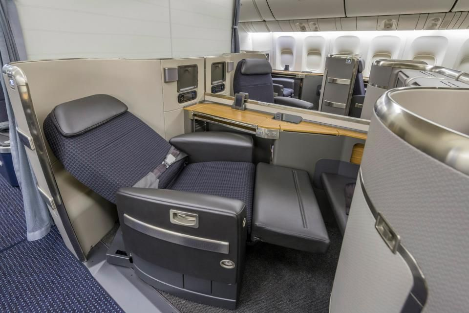 The Boeing 777 300er Cabin Is Configured With Three Classes Featuring Lie Flat Seats In First And Business Class P American Airlines Business Class Airlines