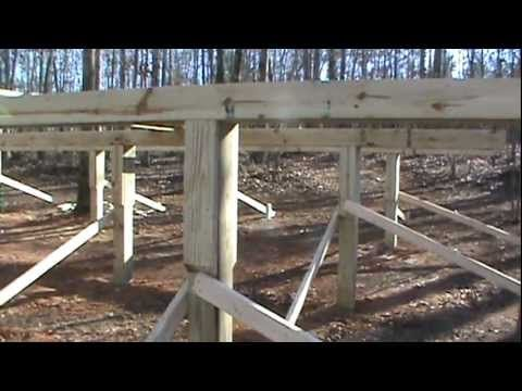 Construction of cabin foundation on 6x6 post and beam for How to build a post and pier foundation