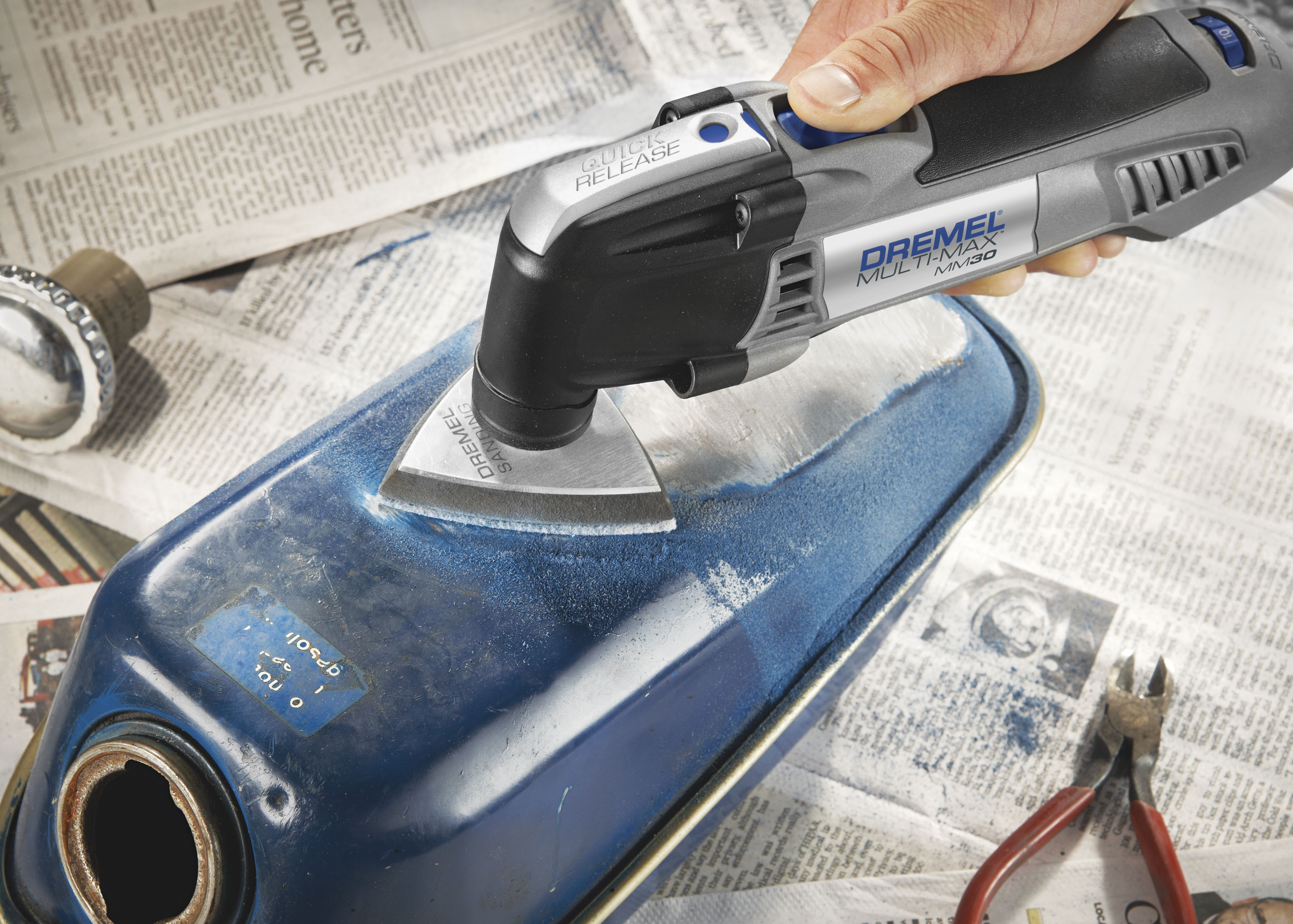 The dremel multi max mm30 removes paint from metal surfaces with this dremel multi max variable speed corded oscillating tool kit with ten accessories and carrying bag is ideal for cutting wood metal and removing grout dailygadgetfo Choice Image