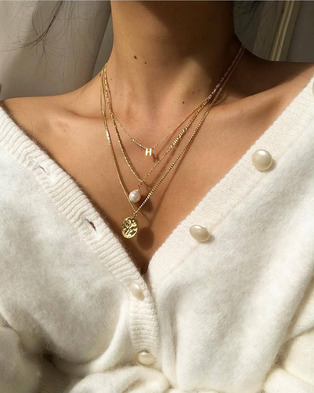 "Photo of S-kin Studio Jewelry on Instagram: ""Good things come in three's ?✨ Hegia is wearing our limited edition Anniversary Collection, top to bottom: Initial Necklace, Kaia Pearl…"""