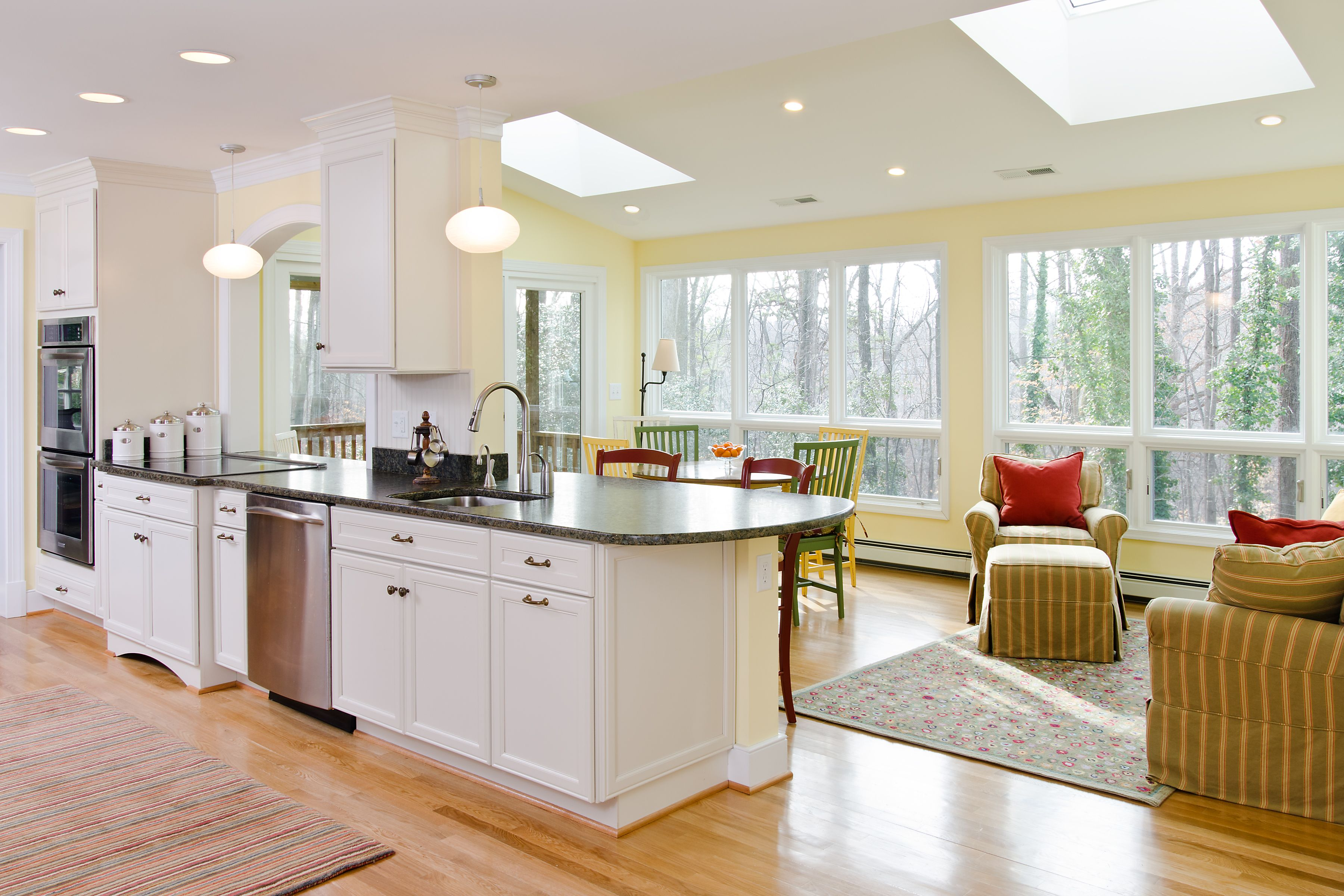 This project included opening the kitchen to an existing sunroom ...