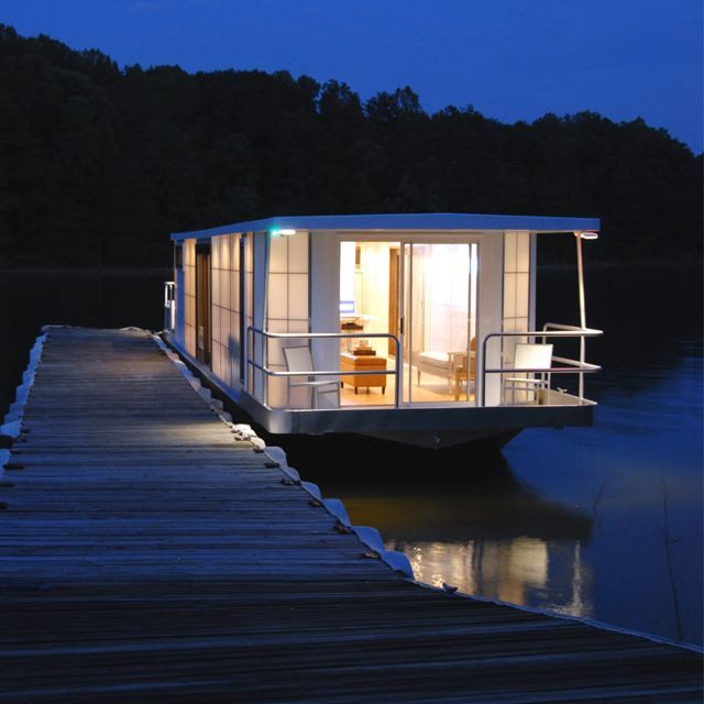 I really do want to live on one of these for about six months! Houseboat