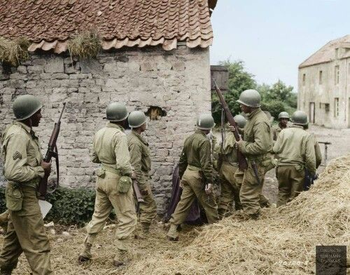 A Platoon Of African American Troops Surrounds Farm House In Town France