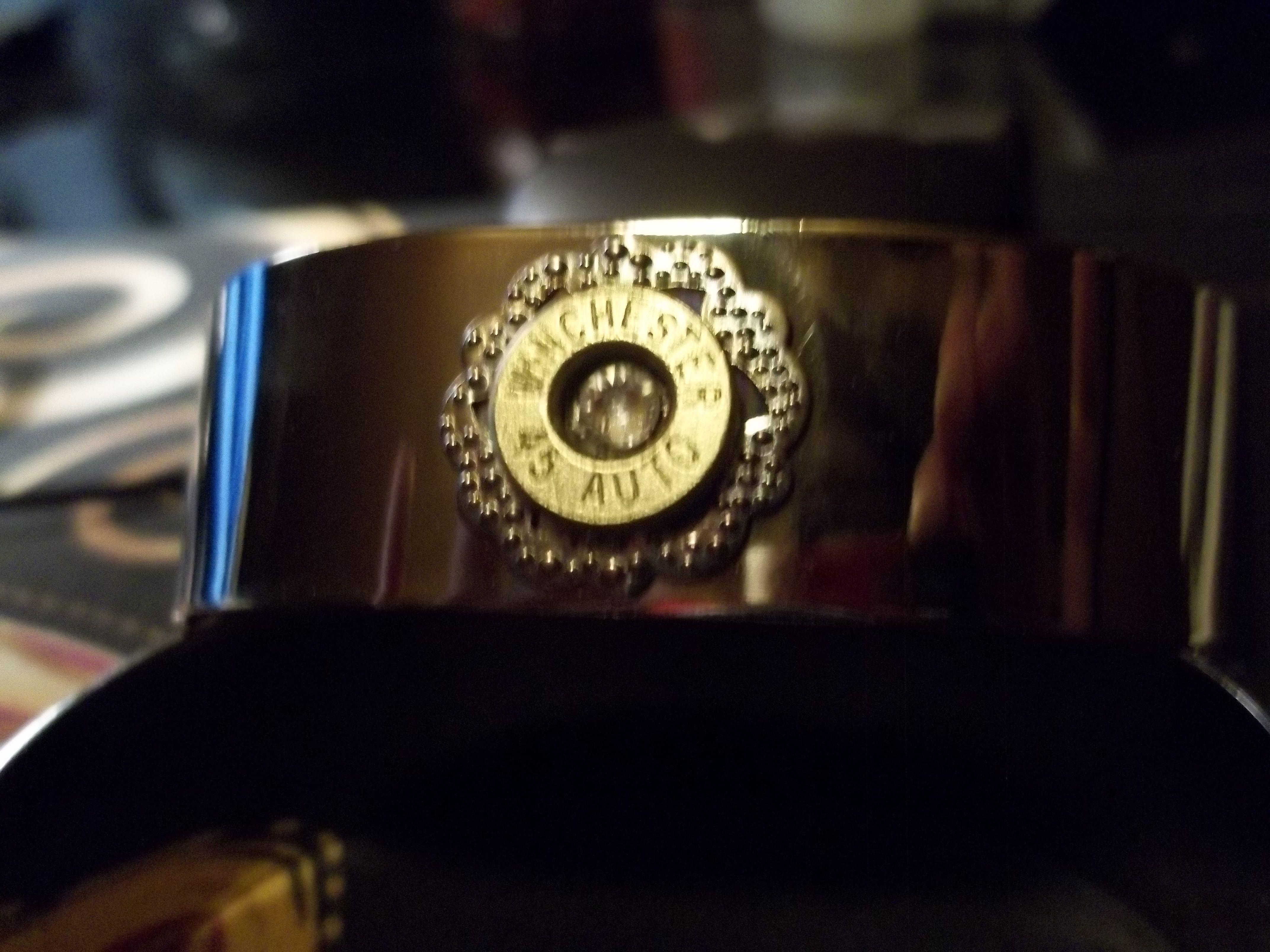 Silvertone cuff bracelet with Clear Swarovski crystal. $35.00.