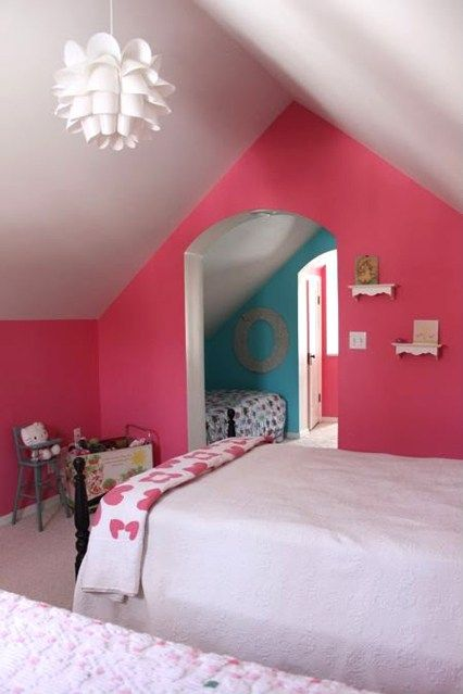 You may not sign up for the pink-for-a-girl, blue-for-a-boy way of thinking, but you have to admit that in the home of Rachel Burch, this bright pink wall, when combined with the design-led statement light, miniature baroque shelves and kitsch heart throw, is far more cool than cutesy.