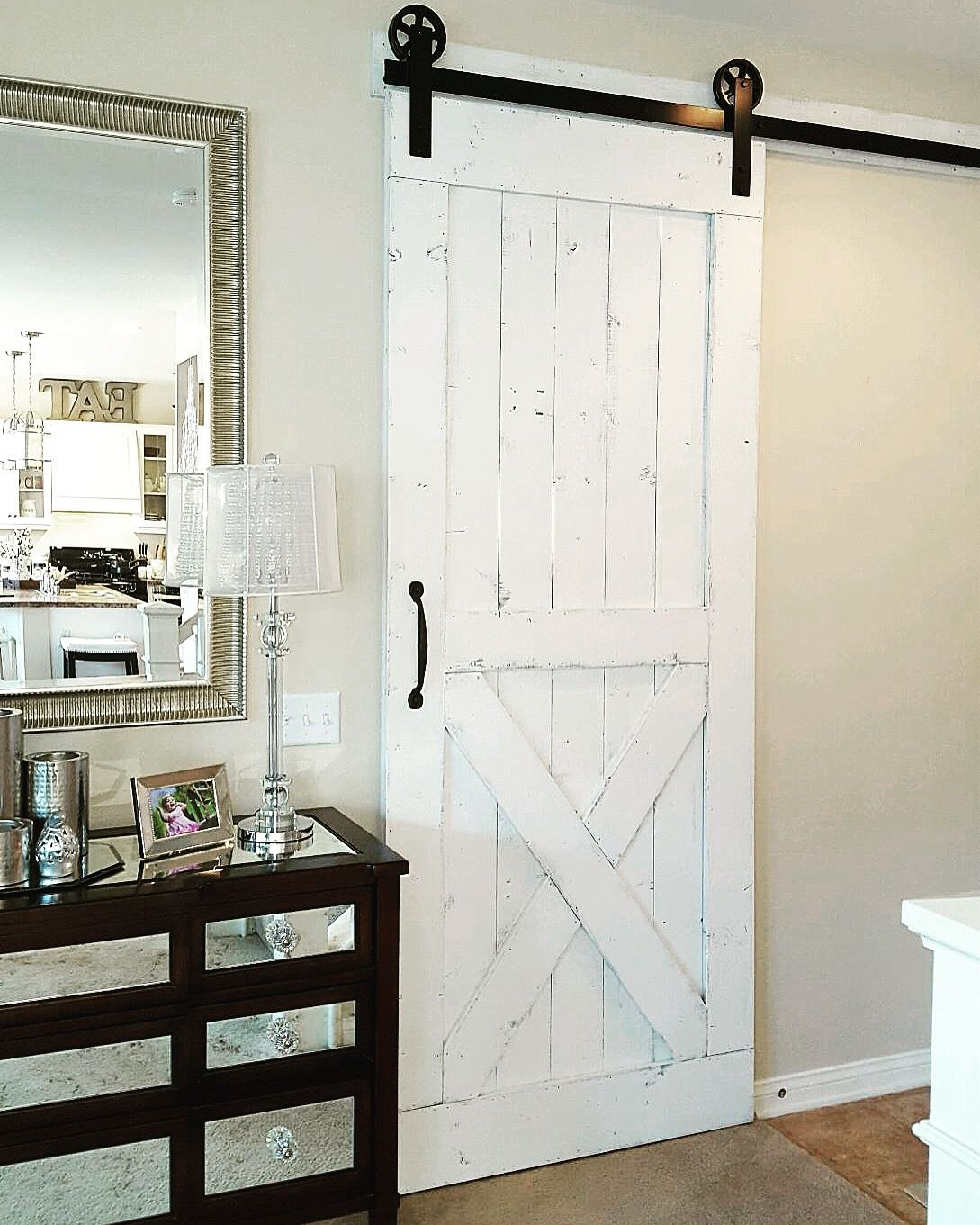 Distressed White Barn Door with Hardware for a living room