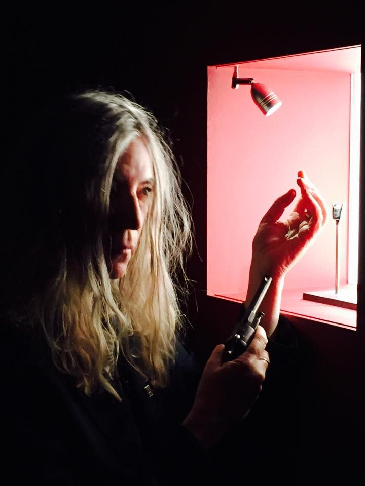 Patti Smith poses with Verlaine revolver currently visible at BAM / Mons