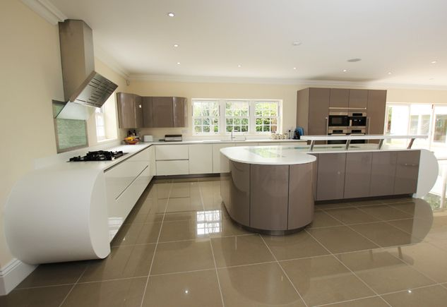 Curved two tone kitchen design with kitchen island, finished in high gloss  lacquer handleless white