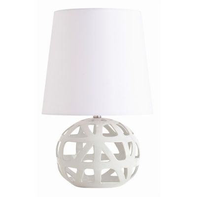 Featuring an edgy open web design, the glossy white finished Wendy Table Lamp is handcrafted from porcelain. Creating contemporary style for any room of the home, this lighting from Arteriors Home is topped with a tall round white shade for an incredibly stunning artistic, modern look. Ideal lighting accessory for the foyer, bedroom, or sunroom!