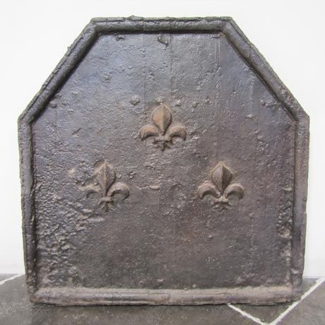Antique firebacks lend an old world charm to your fireplace setting. These cast iron firebacks are hard to find antiques from the past.