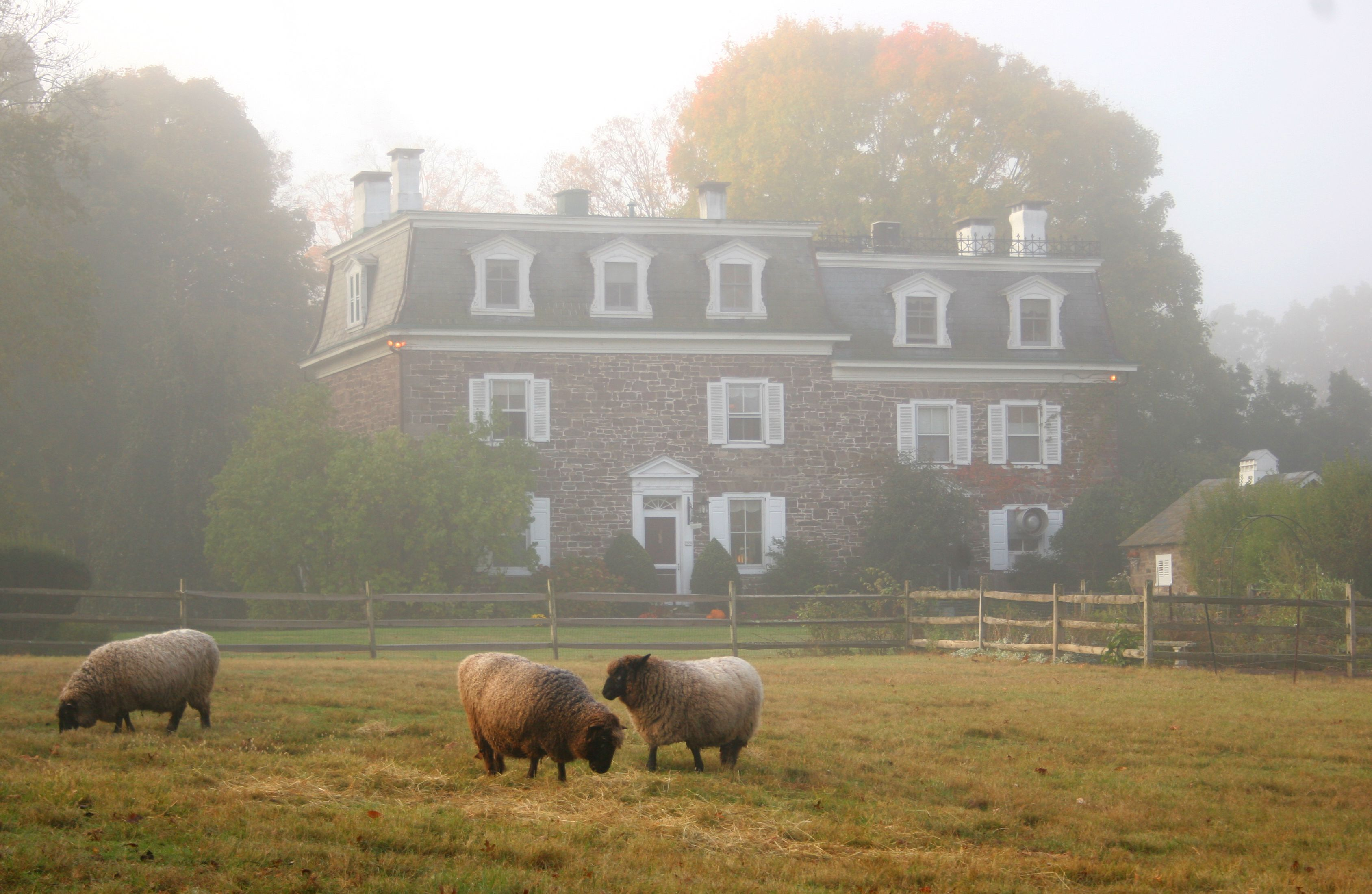 A hazy morning view of the Woolverton Inn. Located in
