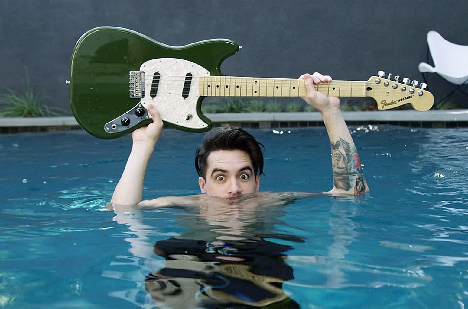 he kinda looks like he 39 s going to throw the guitar but he 39 s just keeping it dry p atd. Black Bedroom Furniture Sets. Home Design Ideas