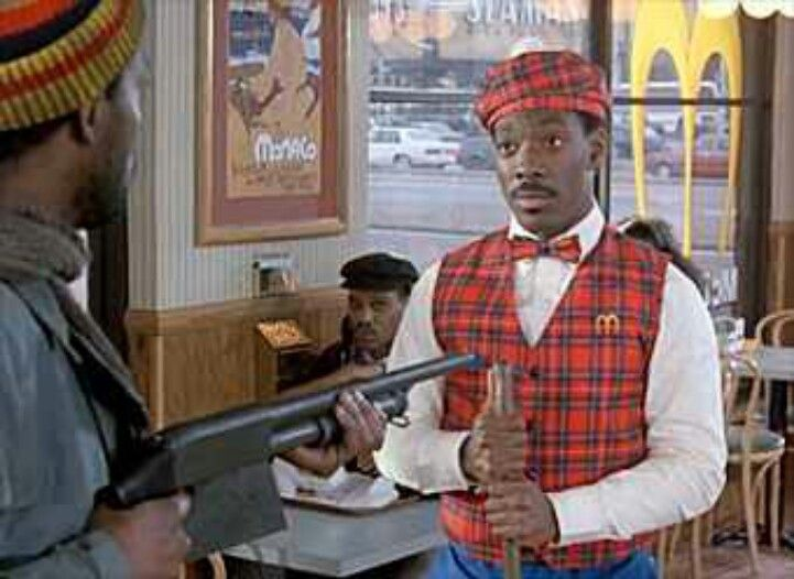 Prince Akeem Eddie Murphy Faces Off Against A Thief Samuel L Jackson During A Hold Up In Mcdowell S Coming To Ameri Eddie Murphy Face Off Favorite Movies