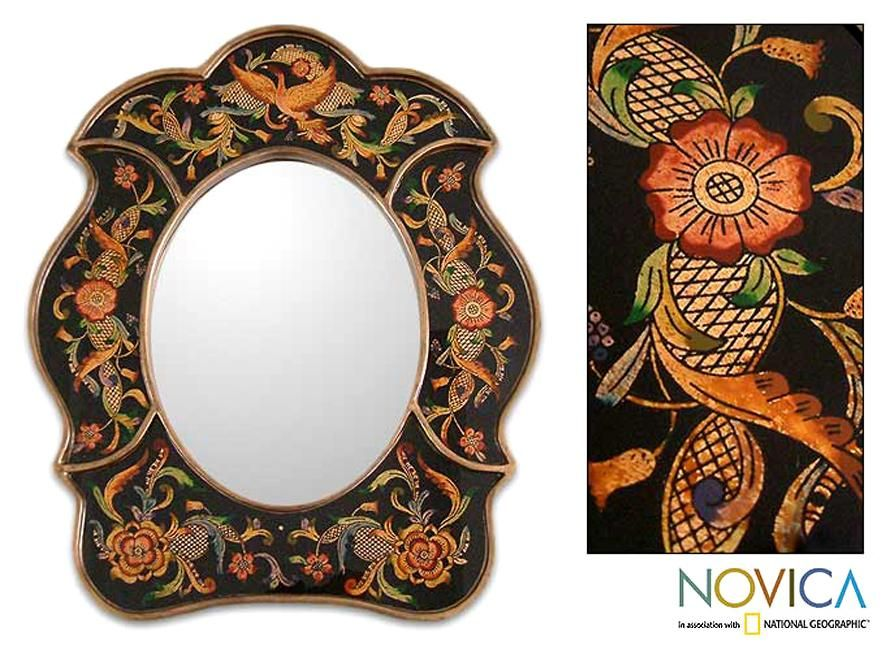 A majestic bird flies over a garden created by Asunta Pelaez for this mirror. She paints the scene by hand on the reverse side of glass to grace a mirror frame unique to the Cajamarca region of Peru.