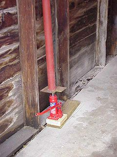 Hydraulic Jack And Lally Column Used To Lift Garage Wall